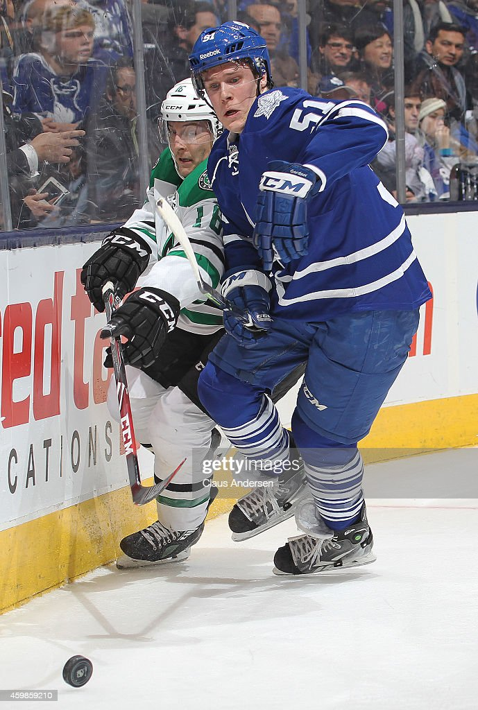 Jake Gardiner #51 of the Toronto Maple Leafs squeezes Ryan Garbutt #16 of the Dallas Stars off the puck during an NHL game at the Air Canada Centre on December 2, 2014 in Toronto, Ontario, Canada. The Leafs defeated the Stars 5-3.