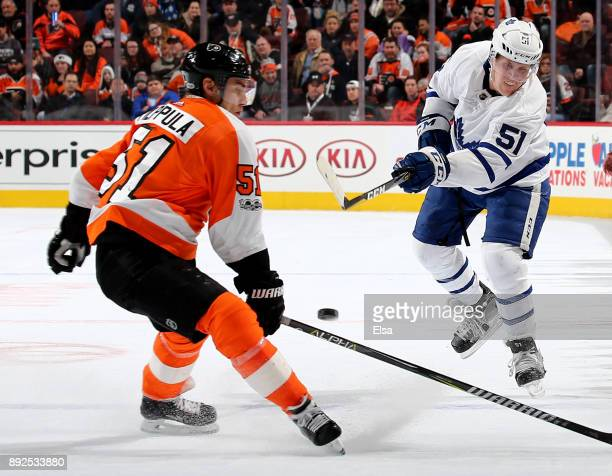 Jake Gardiner of the Toronto Maple Leafs takes a shot as Valtteri Filppula of the Philadelphia Flyers defends on December 12 2017 at Wells Fargo...