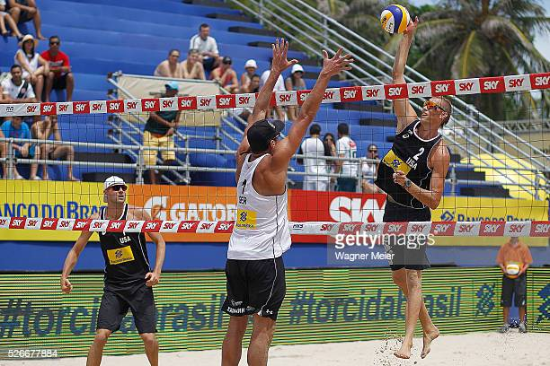 Jake Gibb and Casey Patterson of the United States in action during main draw match against Jonathan Erdmann of Germany during the FIVB Fortaleza...