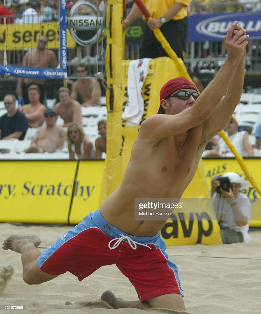 Jake Gibb dives for the ball during the semi final match of the AVP Manhattan Beach Open at the Manhattan Beach Pier in Manhattan Beach, California on June 5, 2004.