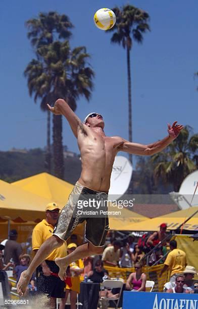 Jake Gibb serves the ball during the AVP 2005 Nissan Series Santa Barbara Open semifinal match up at West Beach on May 22, 2005 in Santa Barbara,...