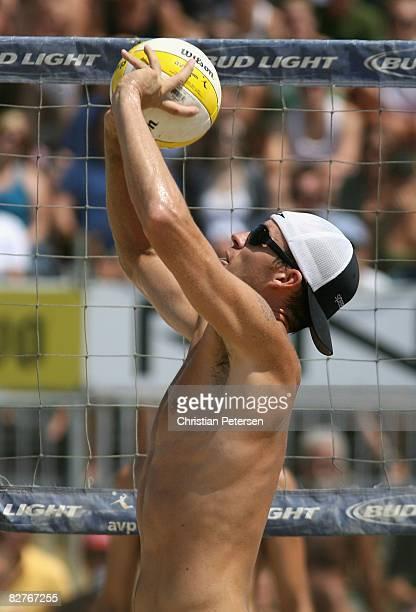 Jake Gibb sets the ball in the AVP Santa Barbara Open semi final match on September 7, 2008 in Santa Barbara, California. Phil Dalhausser and Todd...
