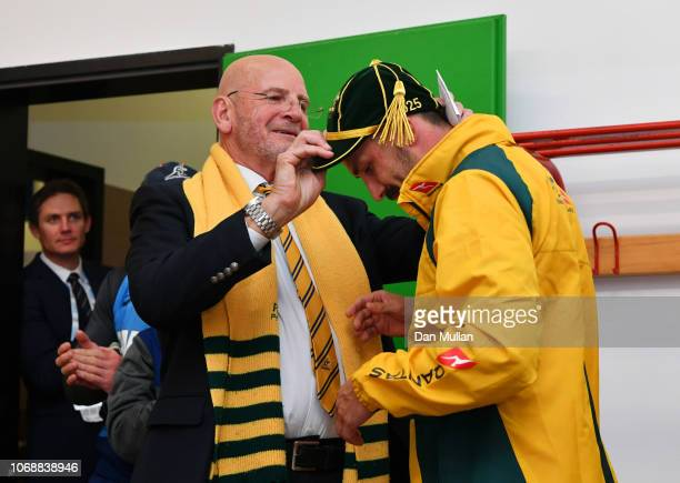 Jake Gordon of Australia is presented with his test debut cap by ARU President Tony Shaw after the international friendly between Italy and Australia...