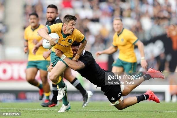 Jake Gordon of the Wallabies is tackled by Ardie Savea of the All Blacks during the Bledisloe Cup match between the New Zealand All Blacks and the...