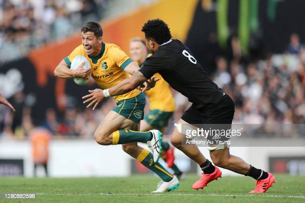 Jake Gordon of the Wallabies makes a run against Ardie Savea of the All Blacks during the Bledisloe Cup match between the New Zealand All Blacks and...