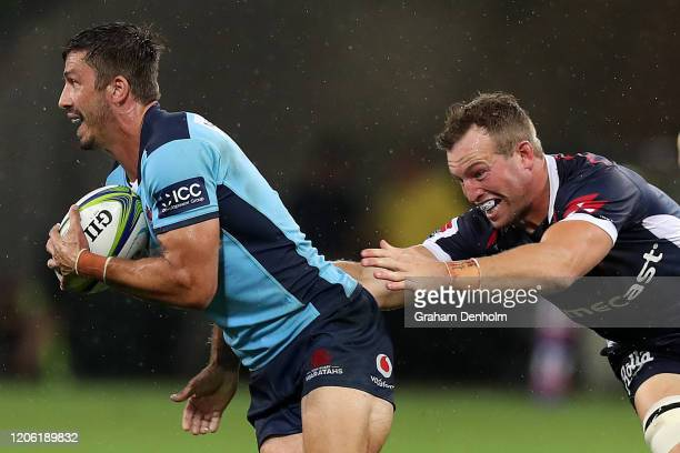Jake Gordon of the Waratahs is tackled during the round 3 Super Rugby match between the Rebels and the Waratahs at AAMI Park on February 14 2020 in...