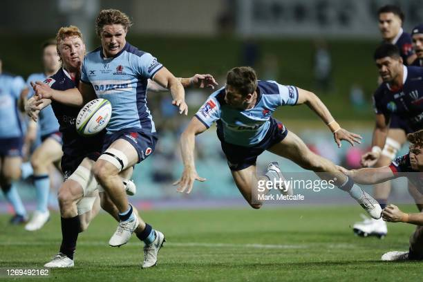 Jake Gordon of the Waratahs offloads to Michael Hooper of the Waratahs during the round nine Super Rugby AU match between the Waratahs and the...
