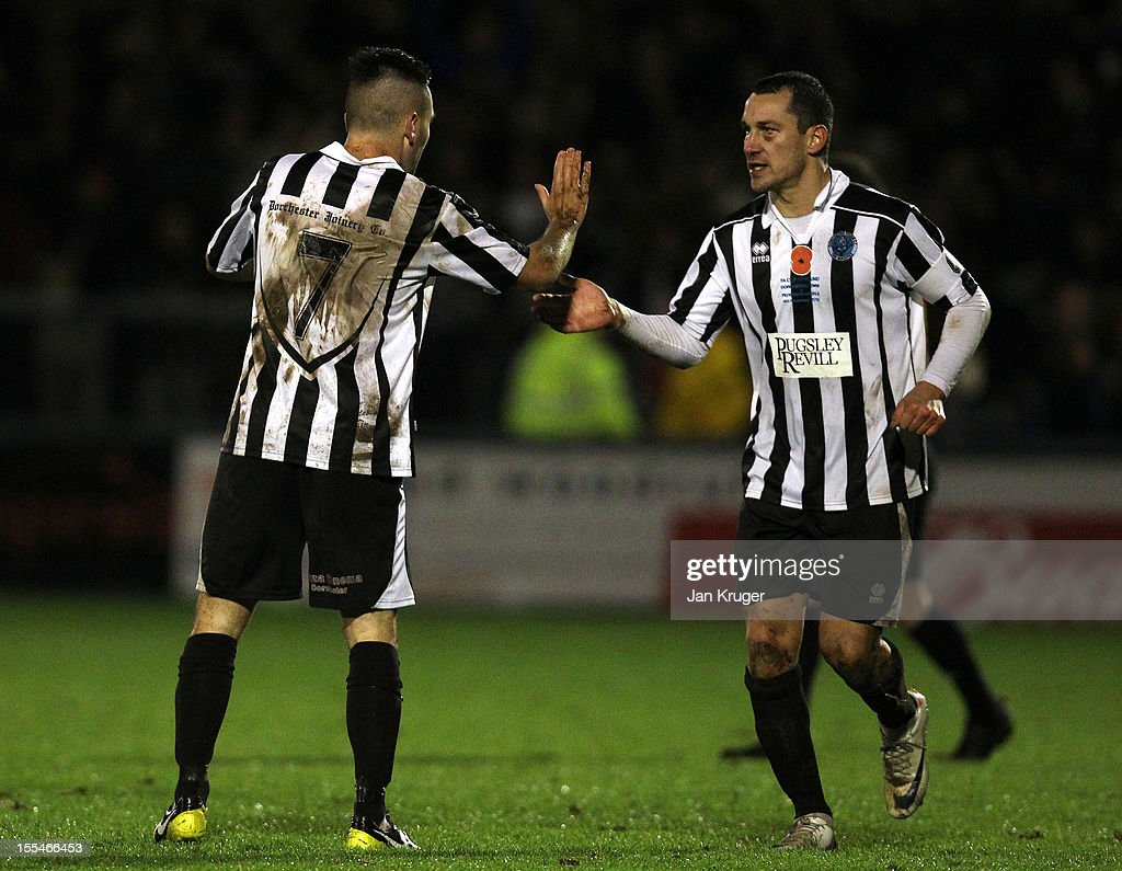 Jake Gosling of Dorchester Town(L) celebrates his goal with team mate Mark Jermyn during the FA Cup with Budweiser 1st Round match between Dorchester Town and Plymouth Argyle at The Avenue Stadium on November 4, 2012 in Dorchester, England.