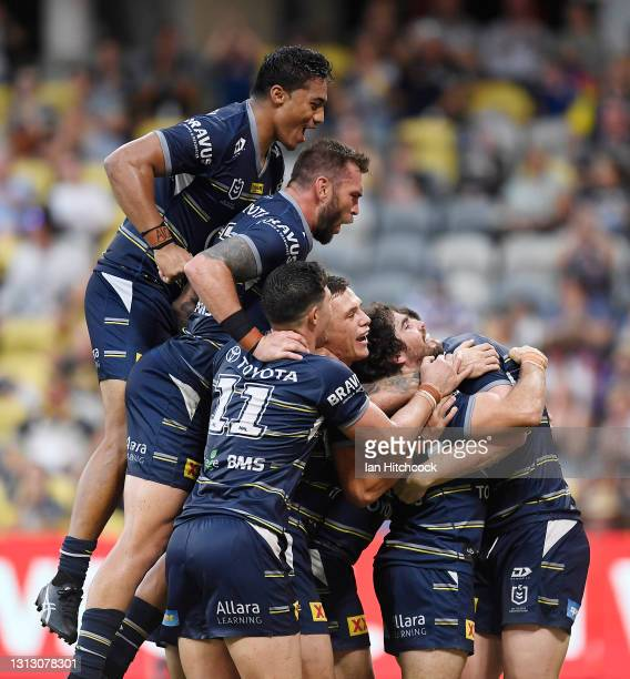 Jake Granville of the Cowboys celebrates after scoring a try during the round six NRL match between the North Queensland Cowboys and the Canterbury...