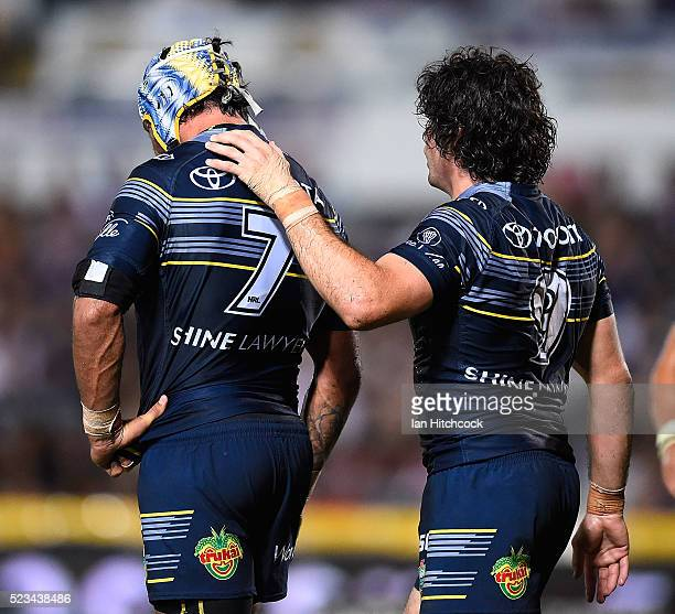 Jake Granville of the Cowboys congratulates Johnathan Thurston of the Cowboys after a Lachlan Coote try during the round eight NRL match between the...