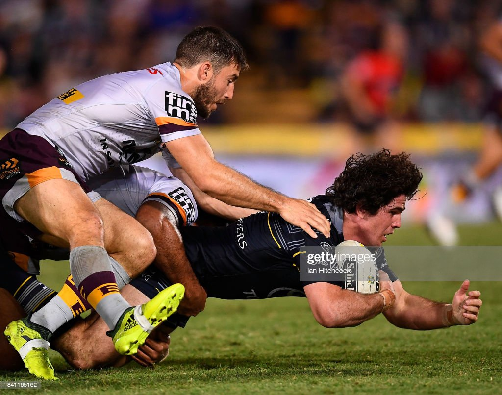 Jake Granville of the Cowboys is tackled by Ben Hunt of the Broncos during the round 26 NRL match between the North Queensland Cowboys and the Brisbane Broncos at 1300SMILES Stadium on August 31, 2017 in Townsville, Australia.