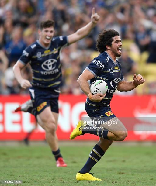 Jake Granville of the Cowboys runs to score a try during the round six NRL match between the North Queensland Cowboys and the Canterbury Bulldogs at...