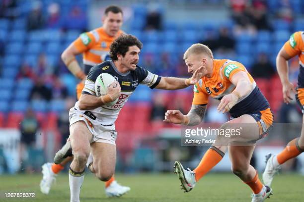 Jake Granville of the North Queensland Cowboys avoids a tackle during the round 15 NRL match between the Newcastle Knights and the North Queensland...