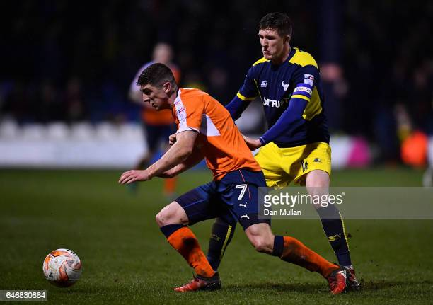 Jake Gray of Luton Town holds off John Lundstram of Oxford United during the EFL Checkatrade Trophy Semi Final match between Luton Town and Oxford...