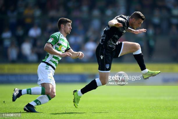 Jake Gray of Yeovil Town and Brennan Dickenson of Colchester United compete for the ball during the Sky Bet League Two match between Yeovil Town and...