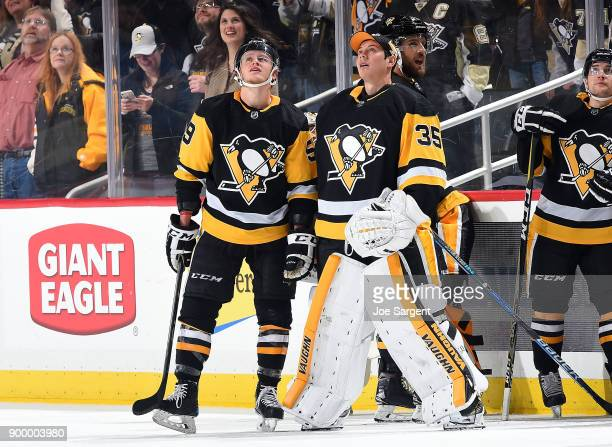 Jake Guentzel and Tristan Jarry of the Pittsburgh Penguins look on during the game against the Columbus Blue Jackets at PPG Paints Arena on December...