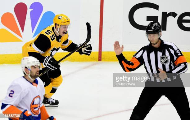 Jake Guentzel celebrates a goal by Sidney Crosby of the Pittsburgh Penguins during the second period in Game One of the First Round of the 2021...