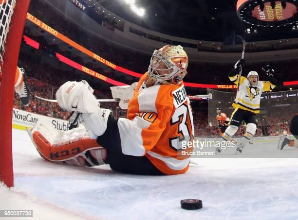 Jake Guentzel of the Pittsburgh Penguins celebrates a first period goal by Sidney Crosby against Michal Neuvirth of the Philadelphia Flyers in Game...