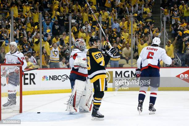 Jake Guentzel of the Pittsburgh Penguins celebrates after deflecting the puck past Braden Holtby of the Washington Capitals for a goal during the...