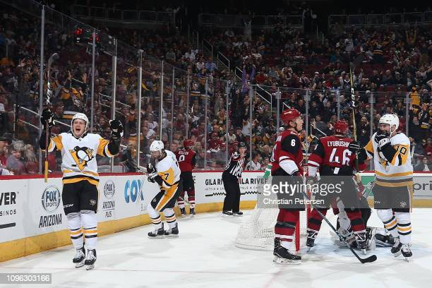 Jake Guentzel of the Pittsburgh Penguins celebrates alongside Matt Cullen after scoring a goal against the Arizona Coyotes during the second period...