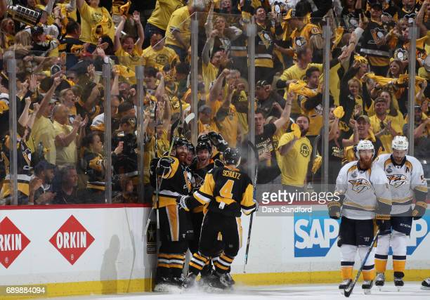 Jake Guentzel of the Pittsburgh Penguins celebrates his gamewinning goal over the Nashville Predators during the third period of Game One of the 2017...