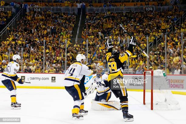 Jake Guentzel of the Pittsburgh Penguins celebrates his goal during the third period against Pekka Rinne of the Nashville Predators in Game One of...