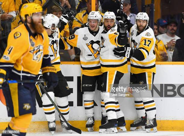 Jake Guentzel of the Pittsburgh Penguins celebrates his goal with teammates during the first period of Game Three of the 2017 NHL Stanley Cup Final...