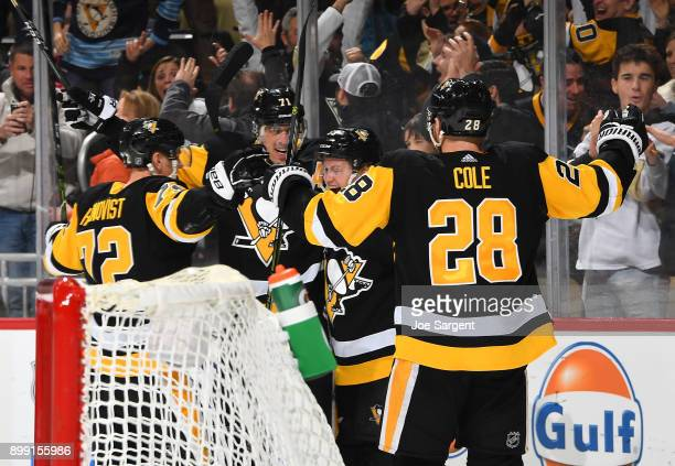 Jake Guentzel of the Pittsburgh Penguins celebrates his goal with teammates during the third period against the Columbus Blue Jackets at PPG Paints...