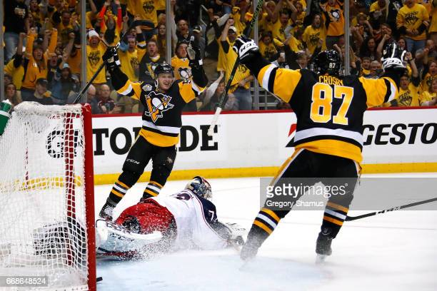 Jake Guentzel of the Pittsburgh Penguins celebrates his second period goal with Sidney Crosby while playing the Columbus Blue Jackets in Game Two of...