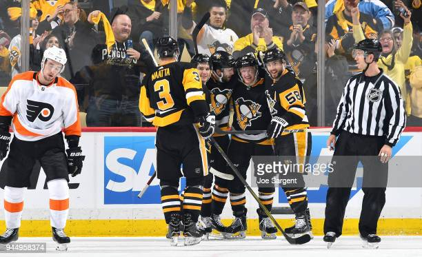 Jake Guentzel of the Pittsburgh Penguins celebrates his second period goal against the Philadelphia Flyers in Game One of the Eastern Conference...