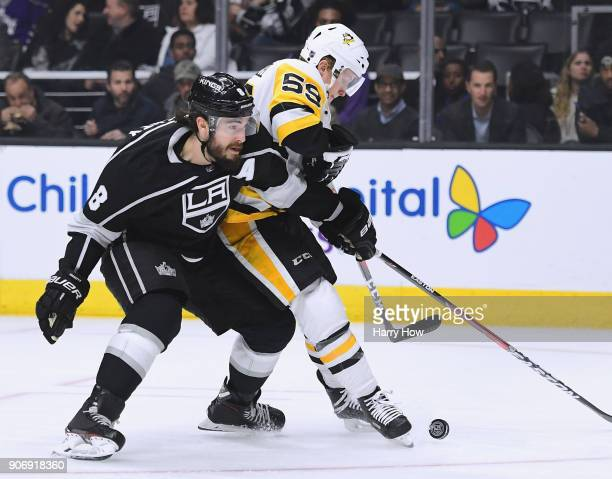 Jake Guentzel of the Pittsburgh Penguins is checked by Drew Doughty of the Los Angeles Kings during the first period at Staples Center on January 18...