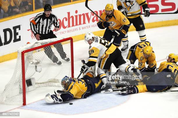 Jake Guentzel of the Pittsburgh Penguins is unable to score on an open net as Pekka Rinne of the Nashville Predators makes a diving save during the...