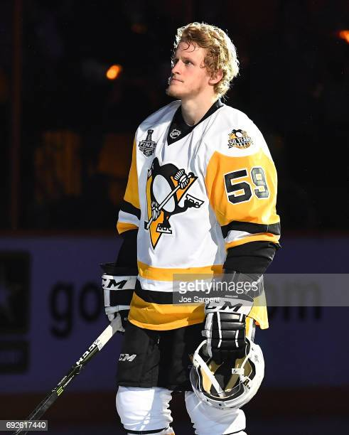 Jake Guentzel of the Pittsburgh Penguins looks on against the Nashville Predators in Game Three of the 2017 NHL Stanley Cup Final at Bridgestone...