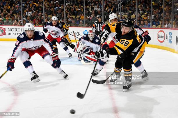 Jake Guentzel of the Pittsburgh Penguins makes a pass against the Columbus Blue Jackets at PPG Paints Arena on December 21 2017 in Pittsburgh...