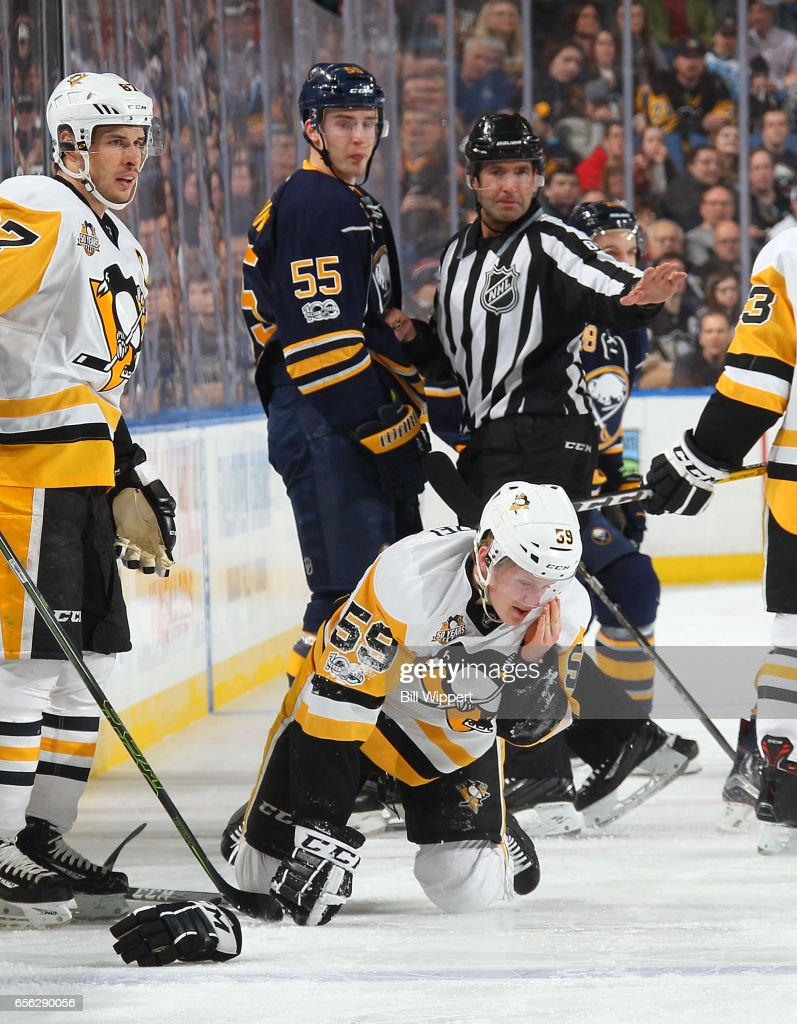 Jake Guentzel #59 of the Pittsburgh Penguins reacts after being injured in a collision with Rasmus Ristolainen #55 of the Buffalo Sabres during an NHL game at the KeyBank Center on March 21, 2017 in Buffalo, New York. Ristolainen received a five minute penalty on the play.