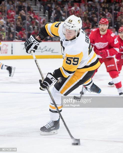 Jake Guentzel of the Pittsburgh Penguins shoots the puck against the Detroit Red Wings during an NHL game at Little Caesars Arena on December 31 2017...
