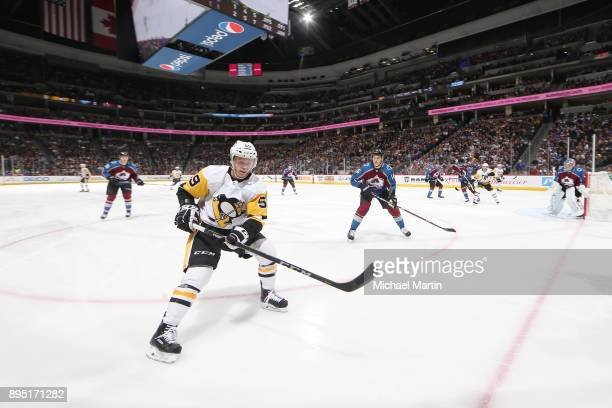 Jake Guentzel of the Pittsburgh Penguins skates against Nikita Zadorov of the Colorado Avalanche at the Pepsi Center on December 18 2017 in Denver...