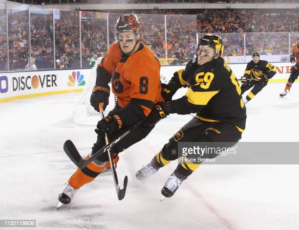 Jake Guentzel of the Pittsburgh Penguins skates against Robert Hagg of the Philadelphia Flyers during the 2019 Coors Light NHL Stadium Series game at...