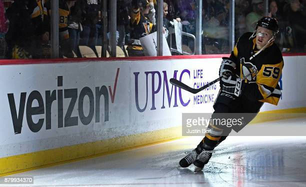 Jake Guentzel of the Pittsburgh Penguins skates out onto the ice before the start of the game against the Vancouver Canucks at PPG PAINTS Arena on...