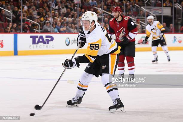 Jake Guentzel of the Pittsburgh Penguins skates with the puck during the NHL game against the Arizona Coyotes at Gila River Arena on December 16 2017...