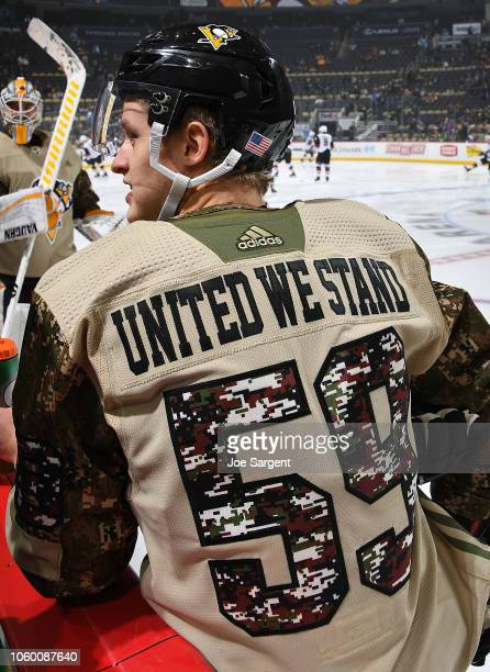 Jake Guentzel of the Pittsburgh Penguins warms up while wearing a camouflage jersey for Military Appreciation Day prior to the game against the...