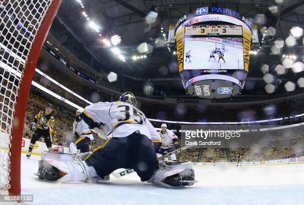 Jake Guentzel of the Pittsburgh Penguins watches after e shot the game winning goal past goaltender Pekka Rinne of the Nashville Predators during the...