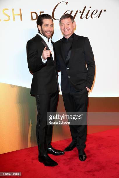 Jake Gyllenhaal and Cyrille Vigneron CEO Cartier during the Clash de Cartier event at la Conciergerie on April 10 2019 in Paris France