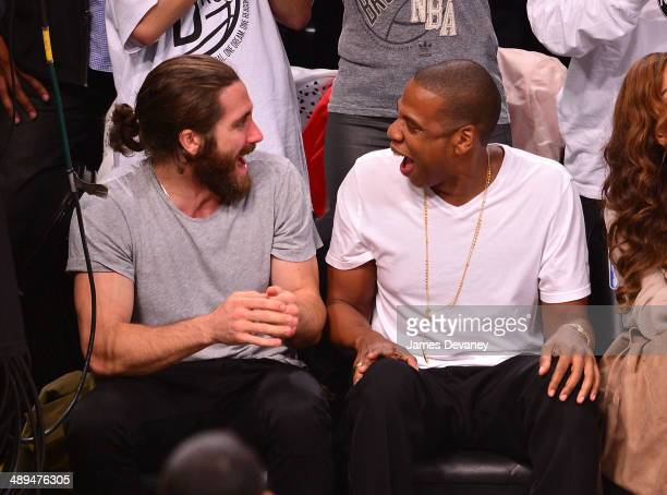 Jake Gyllenhaal and JayZ attend the Miami Heat vs Brooklyn Nets playoff game at Barclays Center on May 10 2014 in the Brooklyn borough of New York...