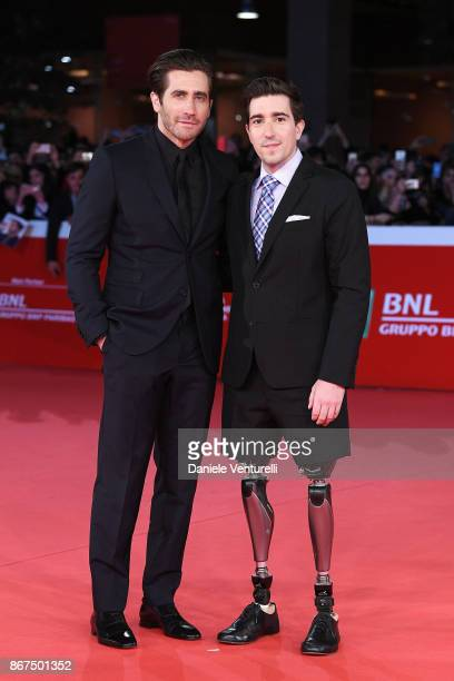Jake Gyllenhaal and Jeff Bauman walk a red carpet for 'Stronger' during the 12th Rome Film Fest at Auditorium Parco Della Musica on October 28 2017...