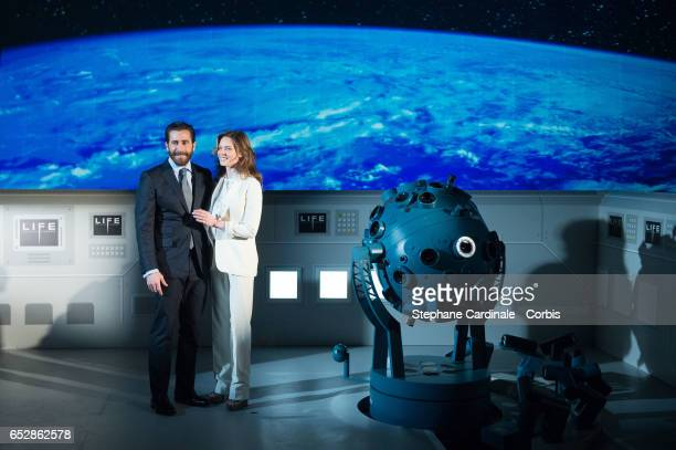 Jake Gyllenhaal and Rebecca Ferguson attend 'Life' Photo Call at Paris Planetarium on March 13 2017 in Paris France