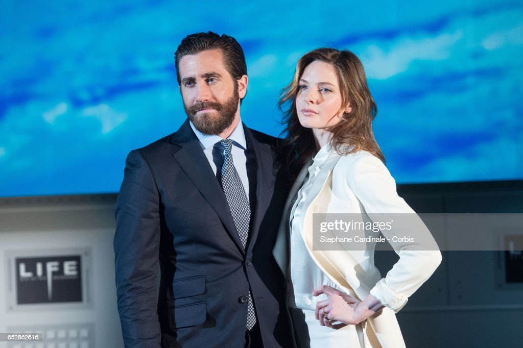 Jake Gyllenhaal and Rebecca Ferguson attend 'Life' Photo Call at Paris Planetarium on March 13, 2017 in Paris, France.