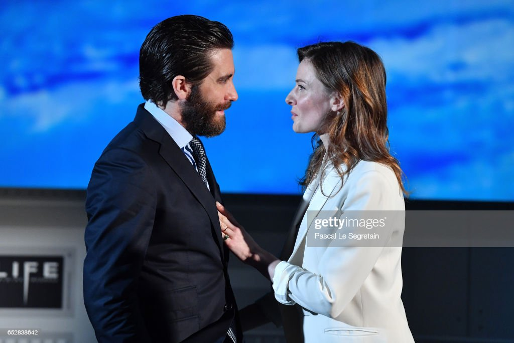 Jake Gyllenhaal and Rebecca Ferguson attend 'Life' Photo Call on March 13, 2017 in Paris, France.