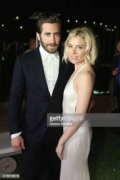 Jake Gyllenhaal and Sienna Miller attend IFP, Calvin Klein Collection & euphoria Calvin Klein celebrate Women in Film at the 68th Cannes Film...