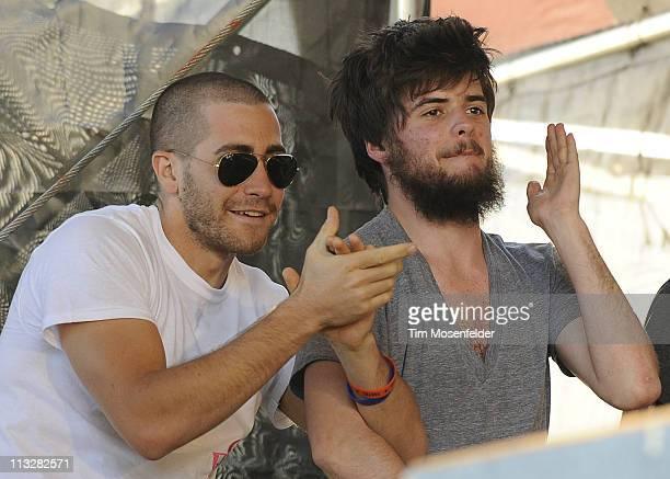 Jake Gyllenhaal and Winston Marshall of Mumford Sons attend The Avett Brothers set at the 2011 New Orleans Jazz Heritage Festival at Fair Grounds...